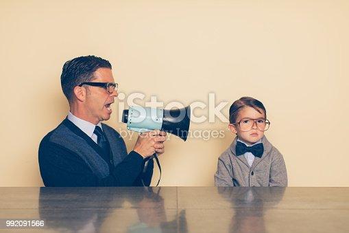 istock Nerd Child not Listening to Dad 992091566