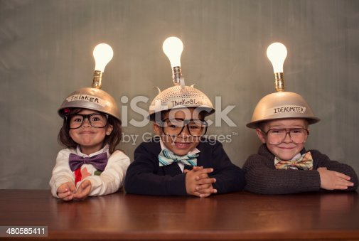 istock Nerd Children Wearing Lighted Mind Reading Helmets 480585411