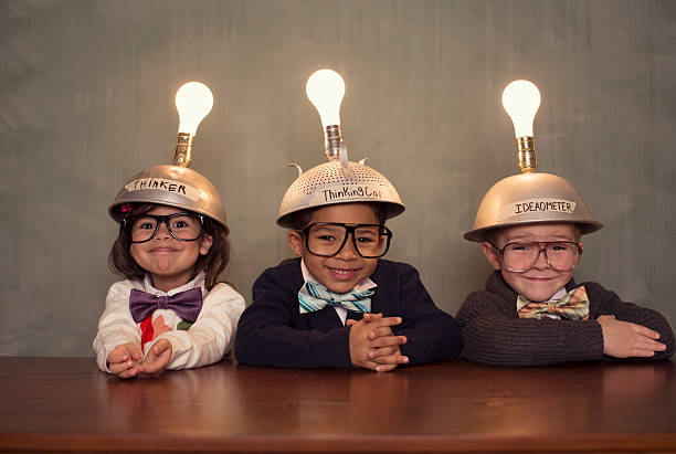 nerd children wearing lighted mind reading helmets - 完美 個照片及圖片檔