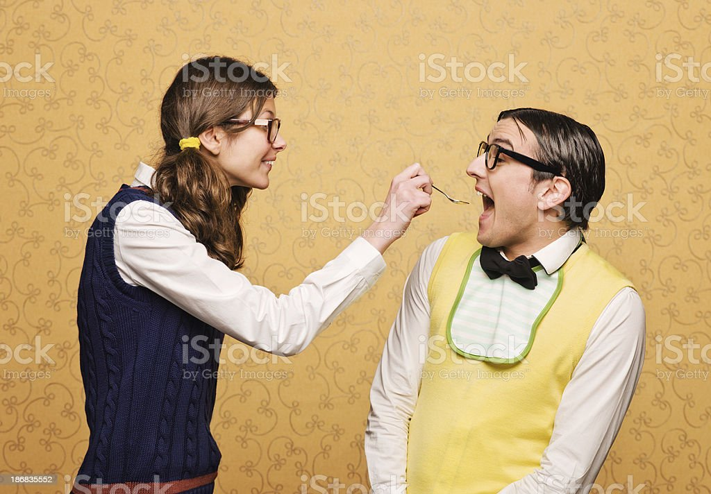 Nerd feeding another royalty-free stock photo