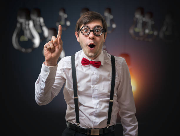 Nerd genius have an idea. Funny man with raised finger. stock photo