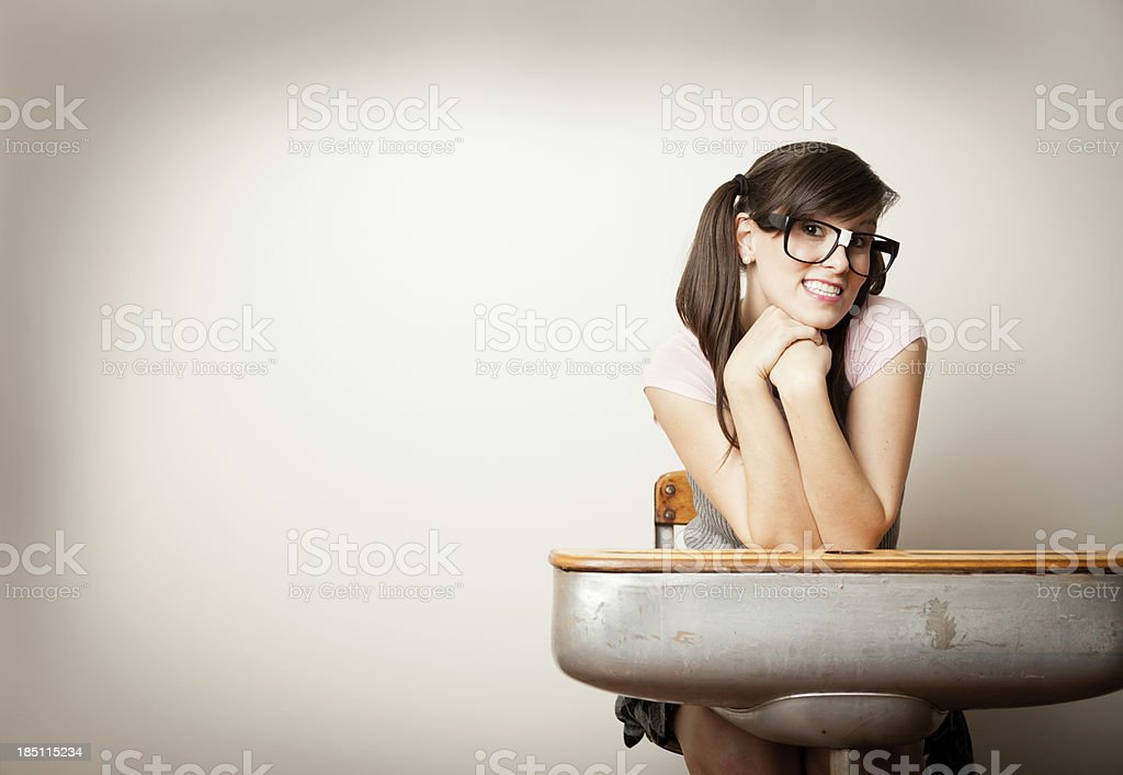 Nerd Girl Sitting at Old School Desk, With Copy Space stock photo