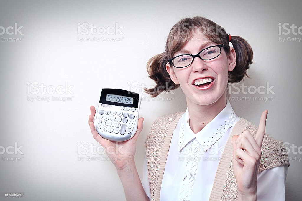 Nerd Girl With Calculator and Copy Space stock photo