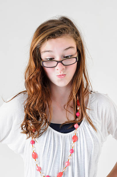Nerd Girl With Crossed Eyes And Big Glasses Pursed Lips Stock Photo