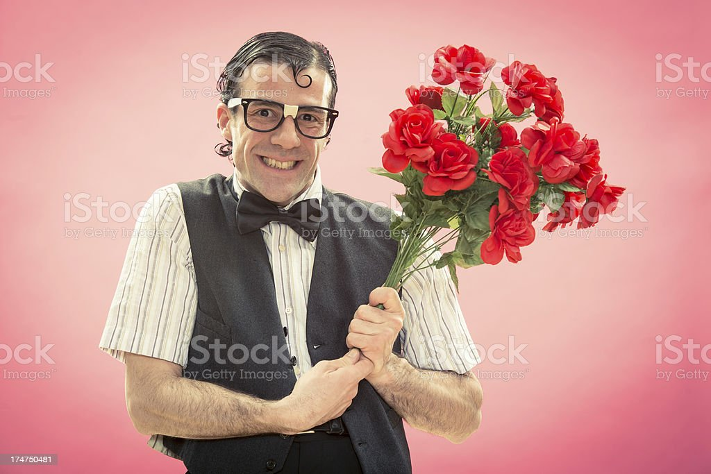 Nerd gives flowers to his girlfriend in valentine day royalty-free stock photo