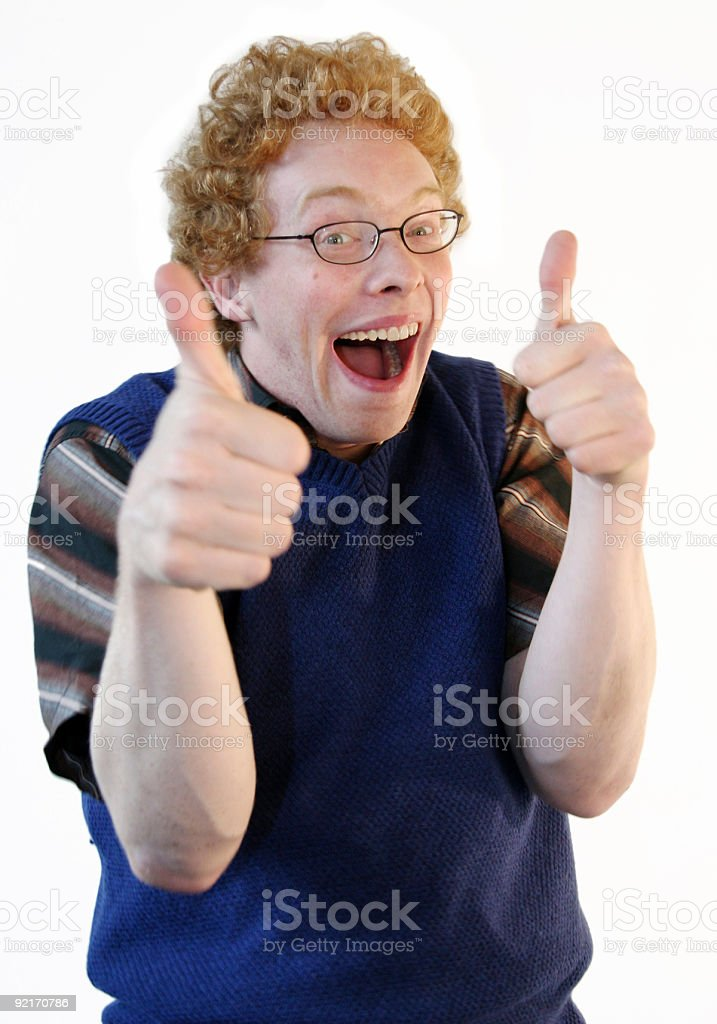 Nerd giving energetic thumbs up stock photo