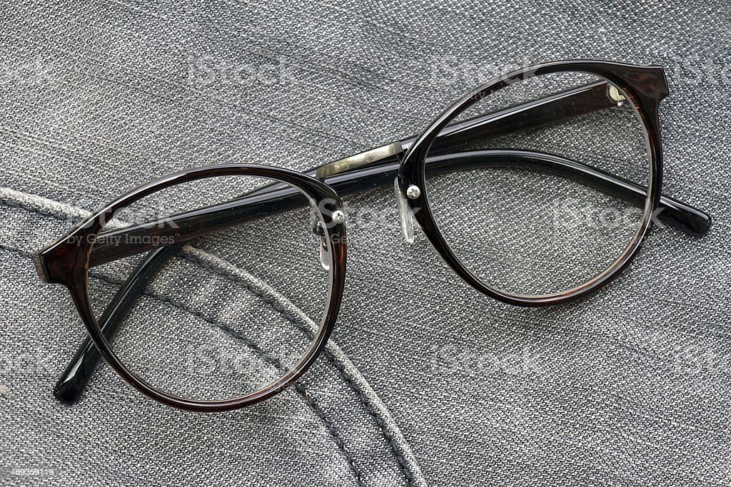 Nerd glasses isolated on blue jeans background. stock photo
