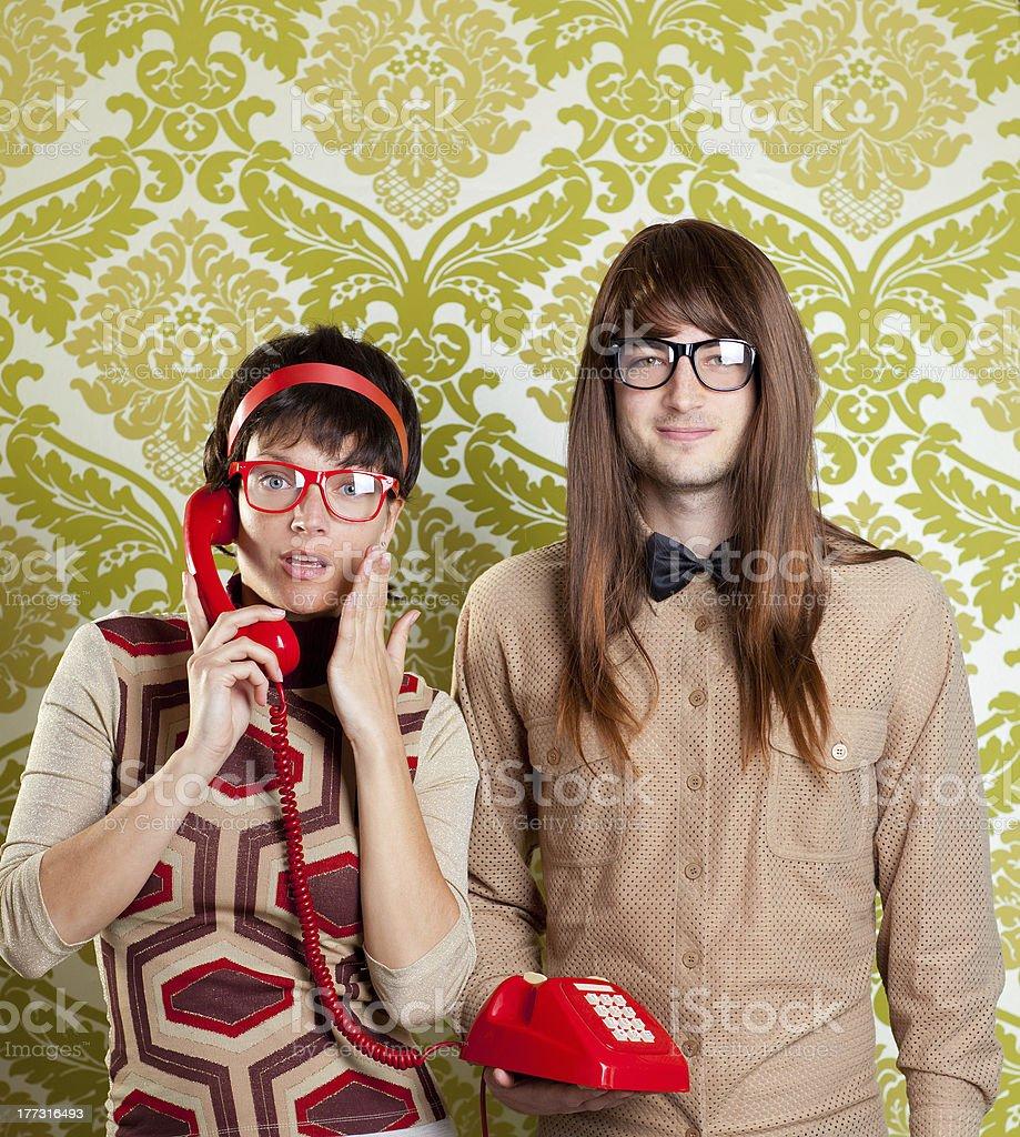 funny nerd humor couple talking retro vintage red telephone on...