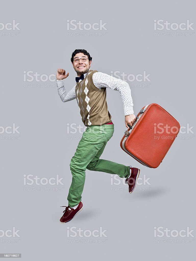 Nerd in air, holding suitcase stock photo