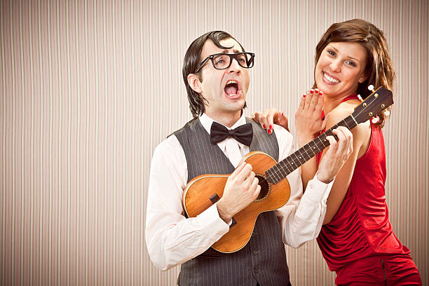 nerd in love with beautiful girl play a serenade song  serenading stock pictures, royalty-free photos & images