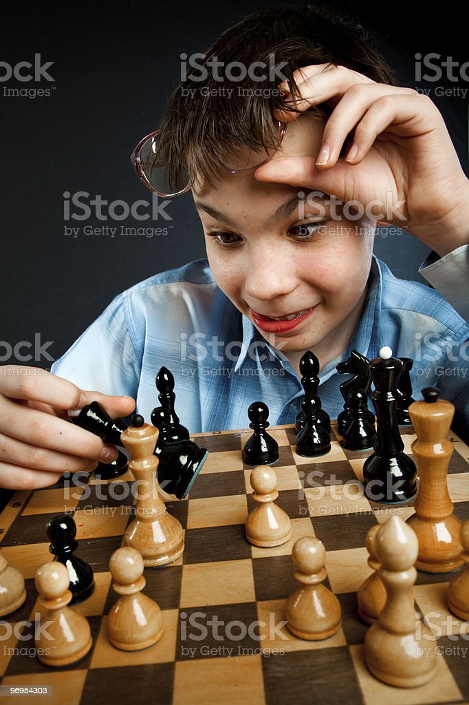 Nerd play chess royalty-free stock photo