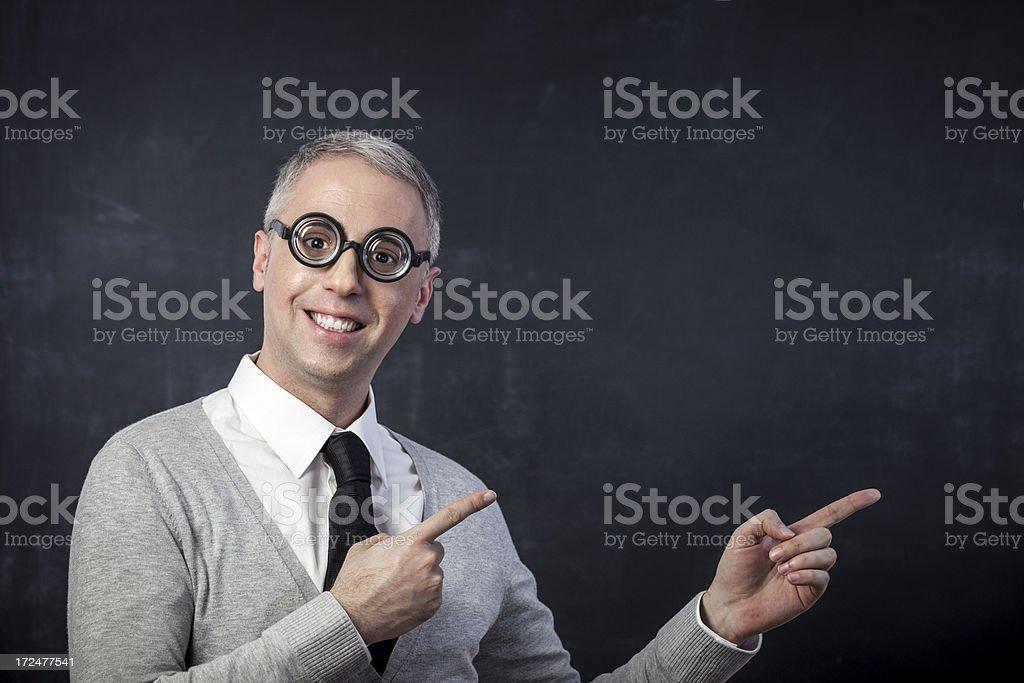 Nerd pointing at blackboard royalty-free stock photo