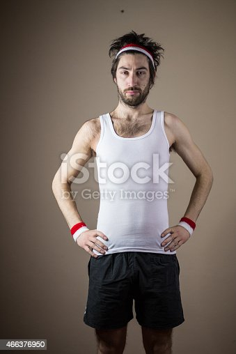 526668973 istock photo Nerd posing in a funny sport clothing 466376950