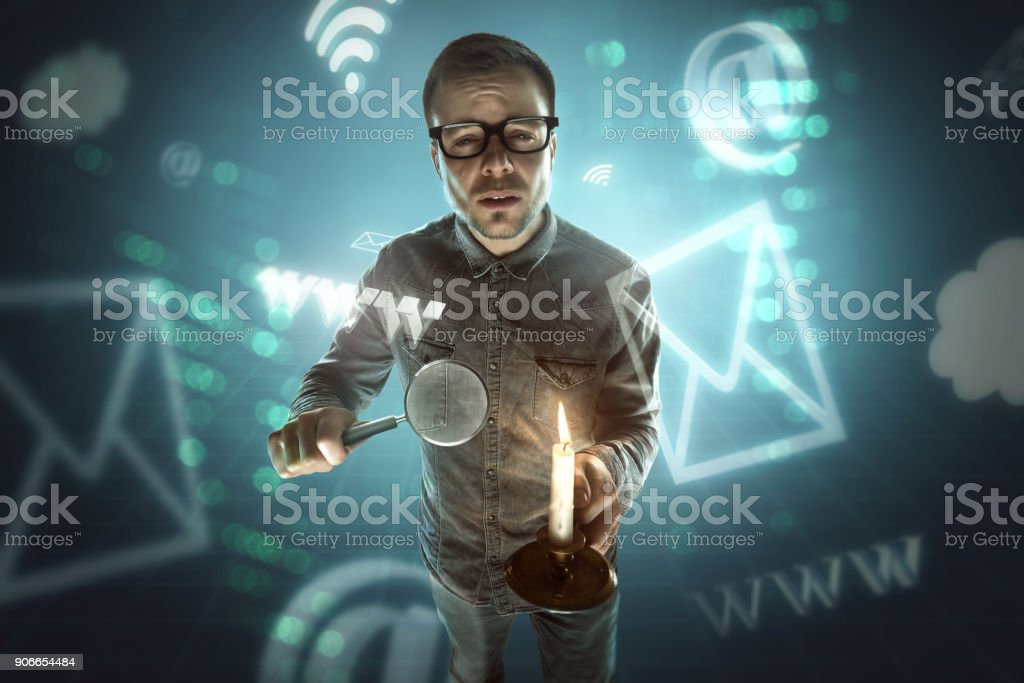 Nerd searching the internet stock photo