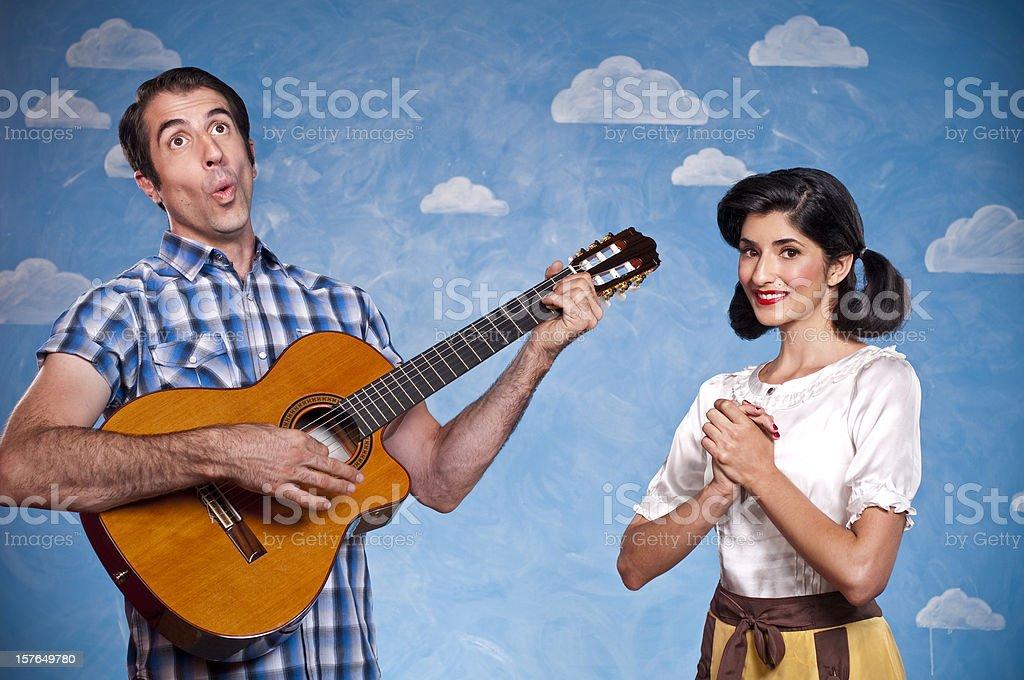 Nerd Serenading His Date stock photo