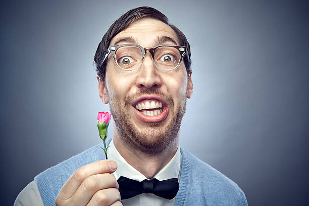 nerd student giving flower - nerd stock photos and pictures