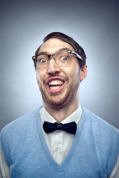 nerd student making a funny smiling face - nerd stock photos and pictures