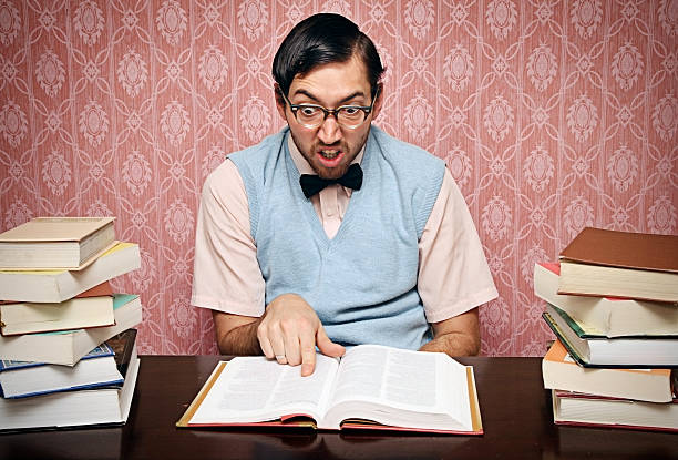 nerd student studies his homework hard - dictionary stock pictures, royalty-free photos & images