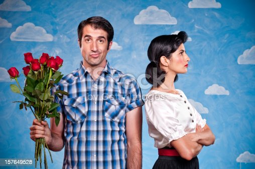 Happy nerd presenting roses to his date. The background is hand painted and the image is shot in the studio.