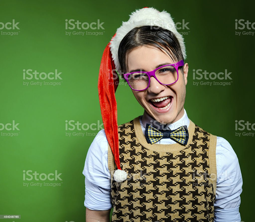 nerd with santa hat stock photo
