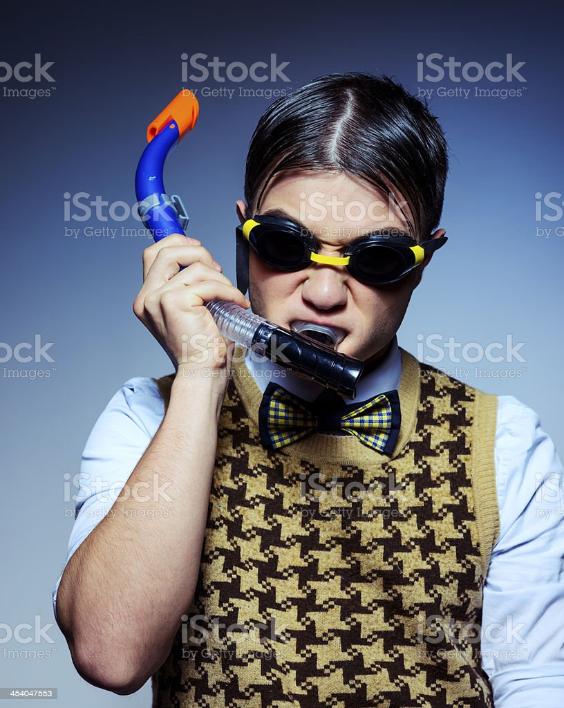 nerd with swimming goggles stock photo