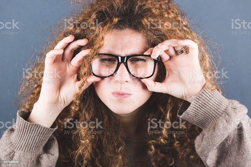 Nerd Woman on Gray Background stock photo