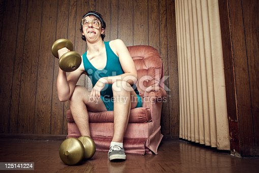 istock Nerd Young Man Exercising with Weights 125141224