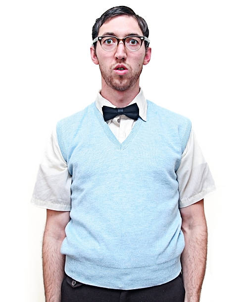Nerd Young Man Isolated on White Lonely looking nerd guy isolated on a white background. Vertical with copy space. nerd stock pictures, royalty-free photos & images