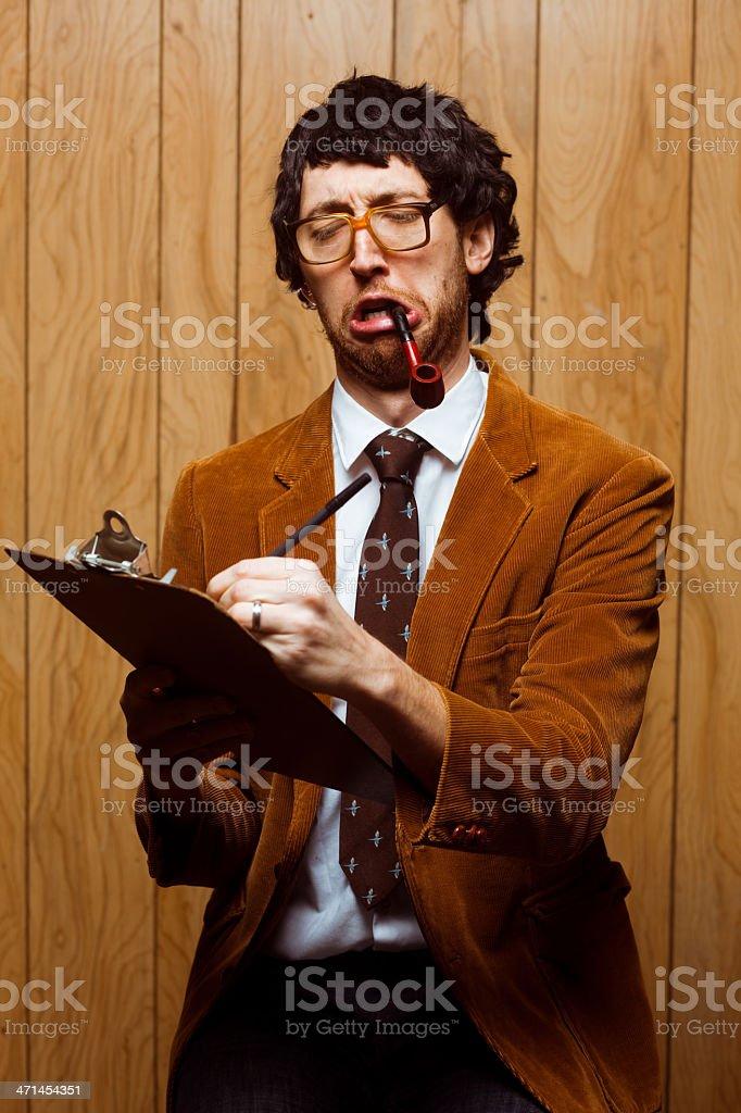 Nerdy 70s College Professor Taking Class Attendance on Clipboard royalty-free stock photo