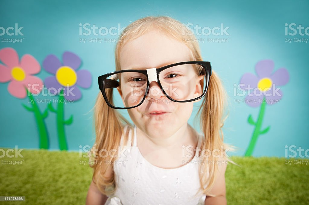 Nerdy, Blond-Haired Little Girl Making Face, in Whimsical World royalty-free stock photo