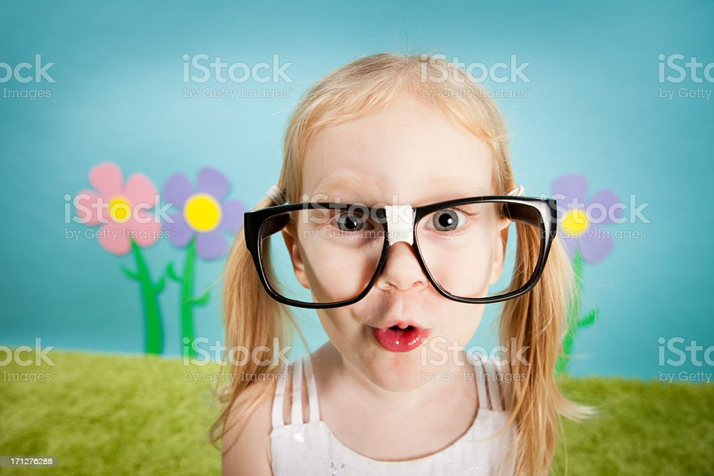 Nerdy, Blond-Haired Little Girl Making Goofy Face royalty-free stock photo