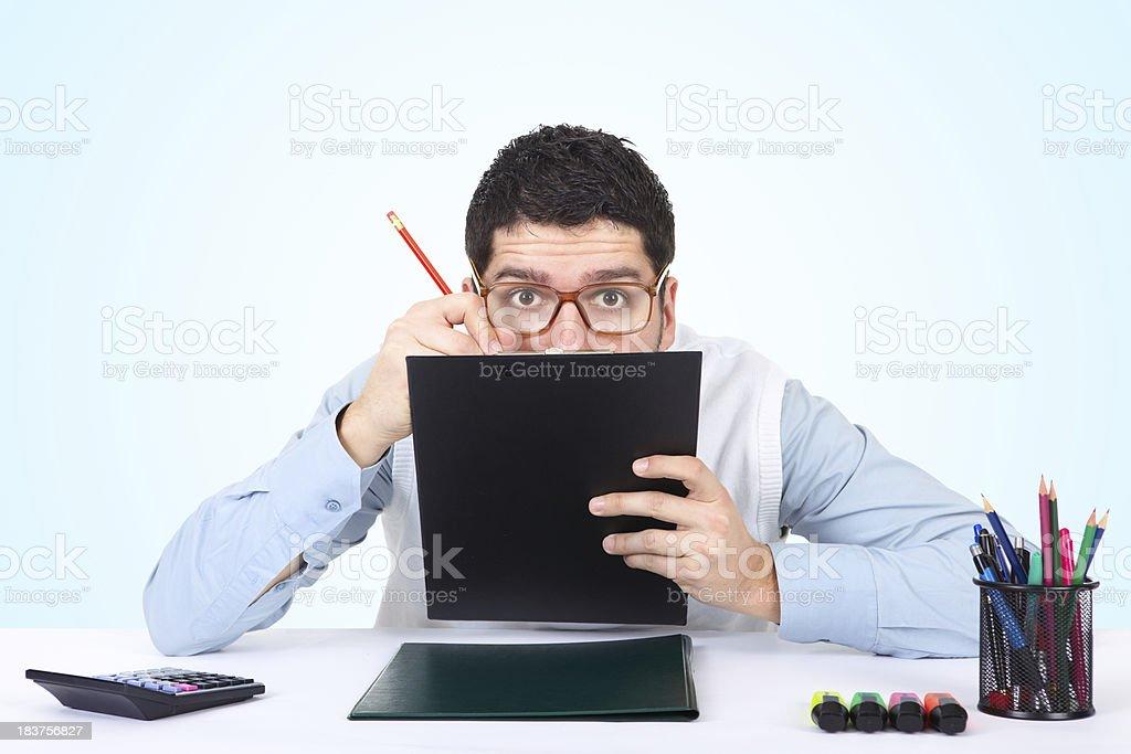 Nerdy businessman writing secret notes royalty-free stock photo