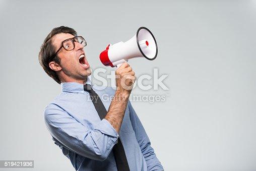 istock Nerdy Businessman Yelling with Megaphone 519421936