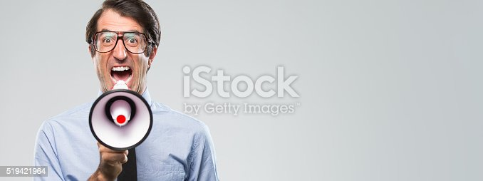 istock Nerdy Businessman Yelling with Megaphone 519421964