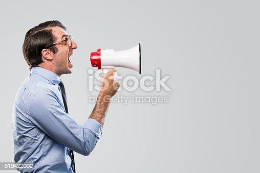 istock Nerdy Businessman Yelling with Megaphone 519422002