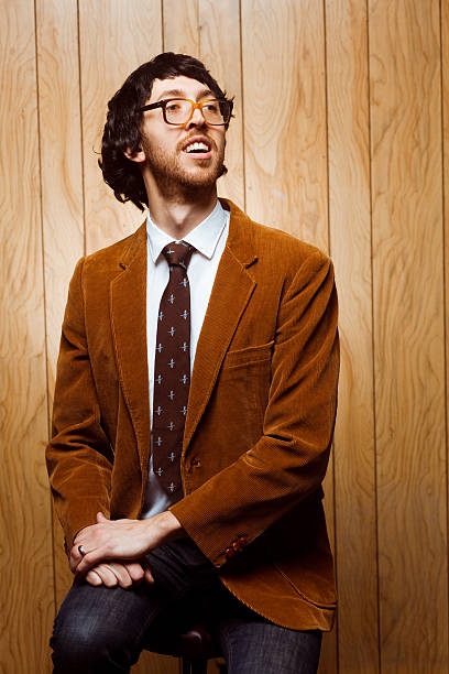 nerdy college professor 1970s portrait looking away - corduroy stock pictures, royalty-free photos & images