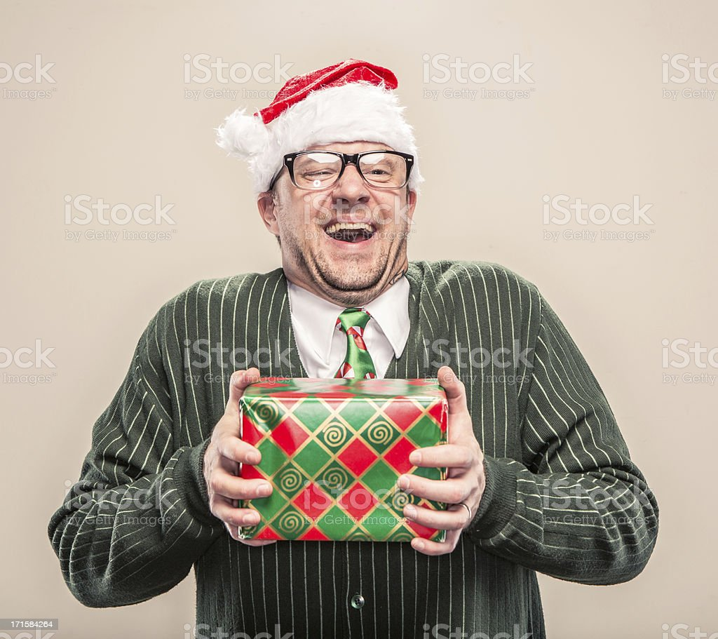 Nerdy Geek Christmas Man holding wrapped holiday gift stock photo
