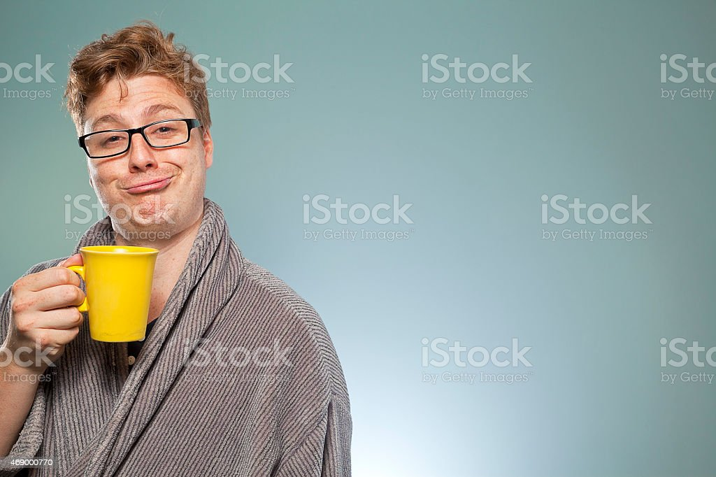 Nerdy guy drinking coffee stock photo