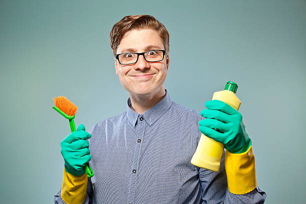 Nerdy guy getting ready to clean stock photo