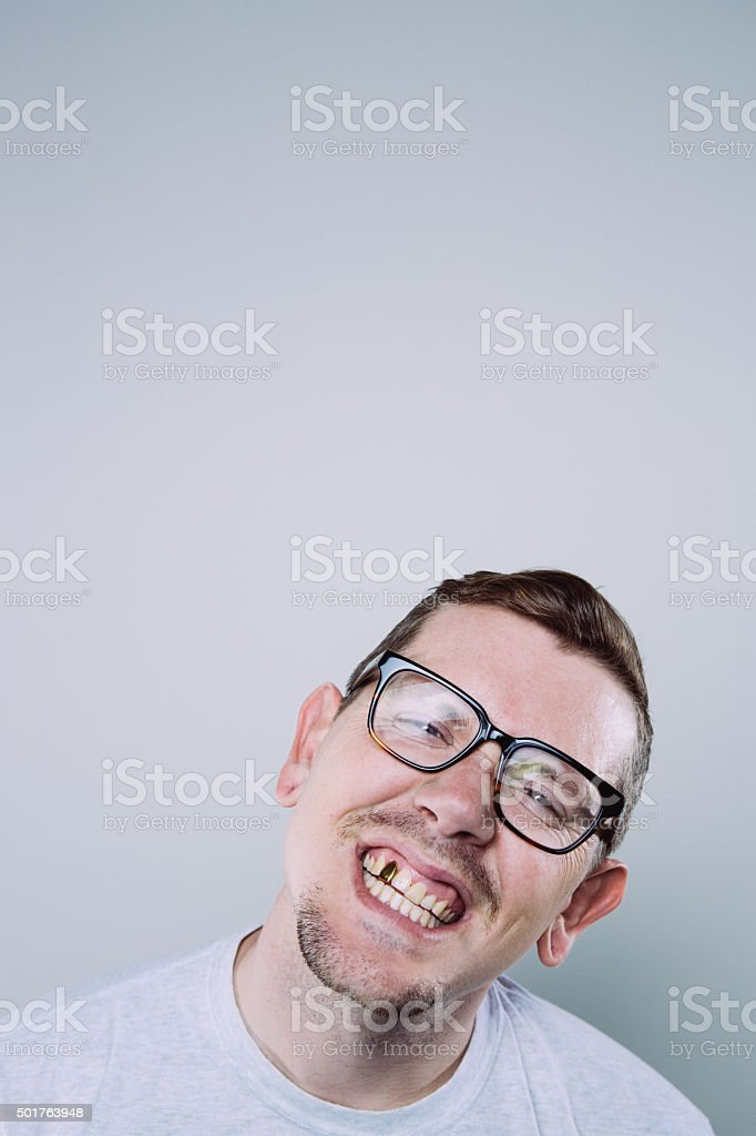 Nerdy Guy with Fake Tooth stock photo