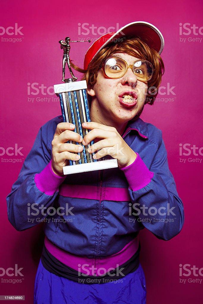 Nerdy sports guy holding a trophy.