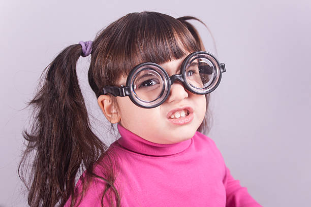 nerdy little girl - ugly girl stock photos and pictures