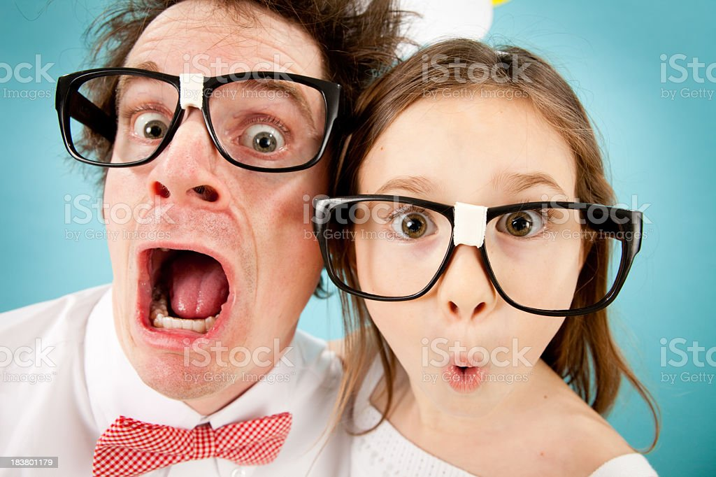 Nerdy Man and Young Girl Gasping with Look of Surprise royalty-free stock photo