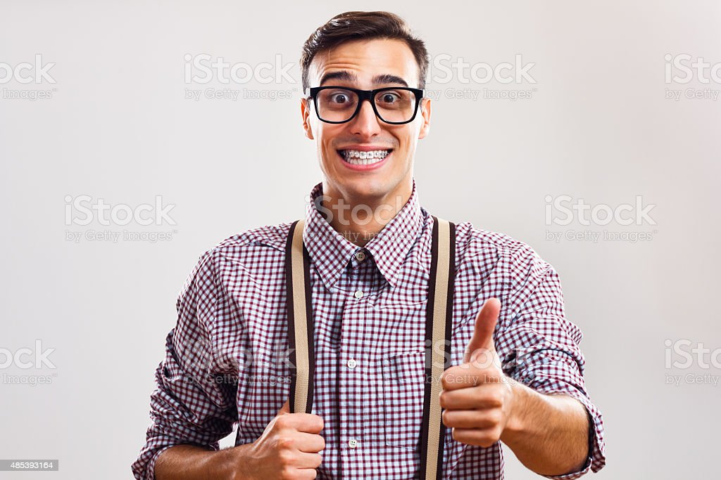 Nerdy man giving thumb up stock photo