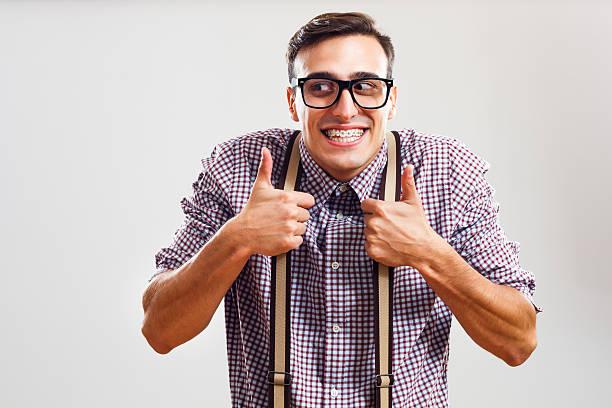 nerdy man giving thumbs up - pantolon askısı stok fotoğraflar ve resimler
