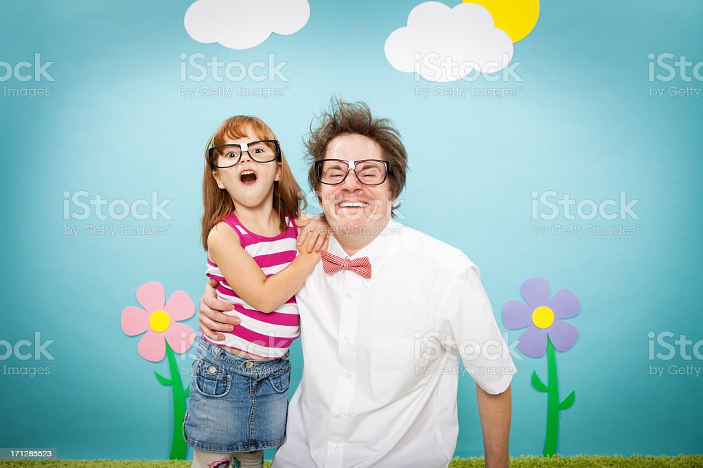 Nerdy Man With Arm Around Little Nerd Girl royalty-free stock photo