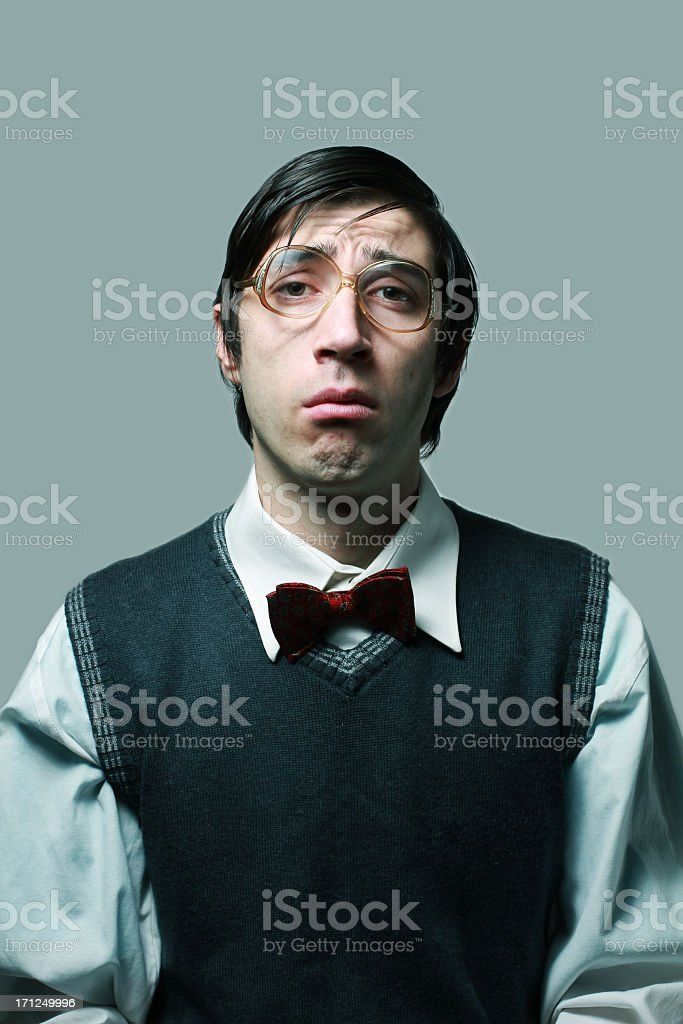 Nerdy man with glasses and bow tie royalty-free stock photo