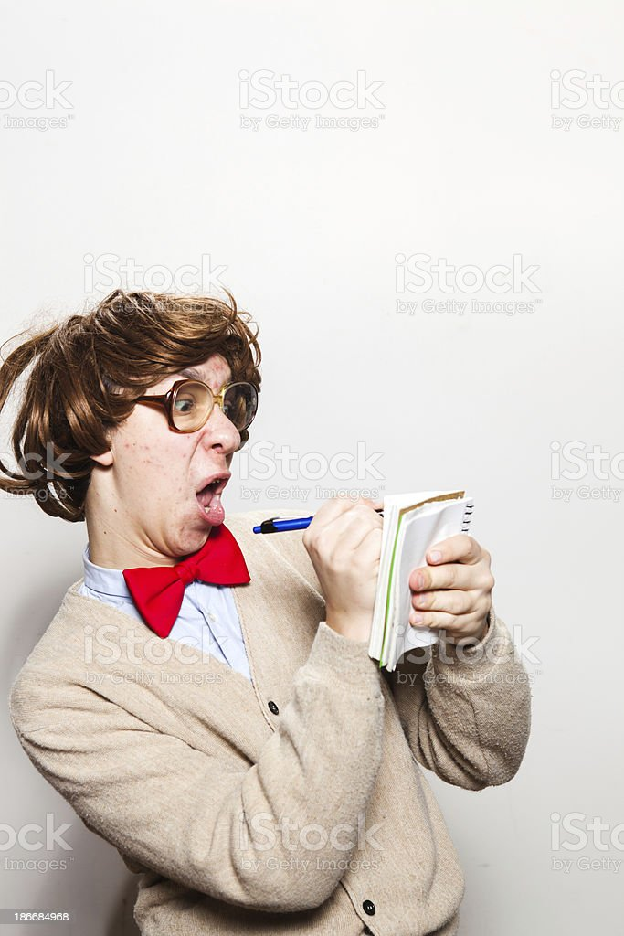Nerdy Office Intern Taking Notes on Notepad royalty-free stock photo