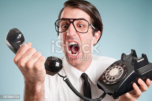 istock Nerdy Office Worker With Vintage Telephone 157564724