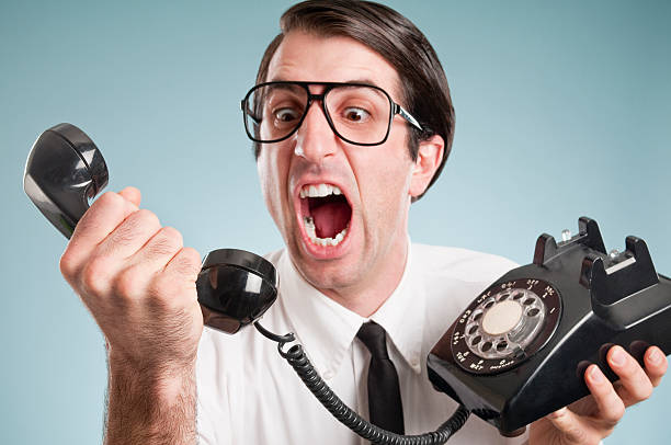 nerdy office worker with vintage telephone - rudeness stock pictures, royalty-free photos & images